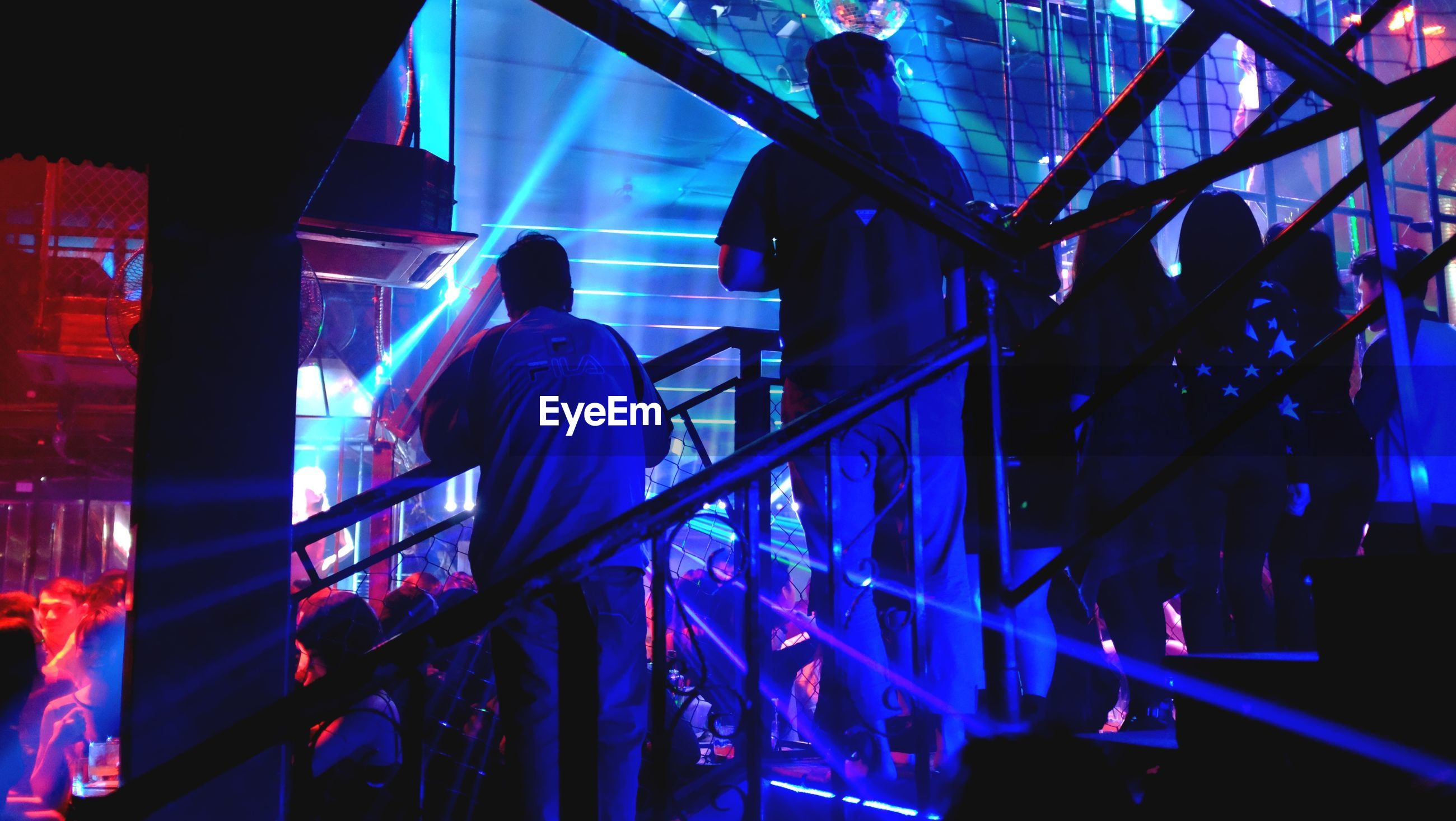 People standing in illuminated nightclub