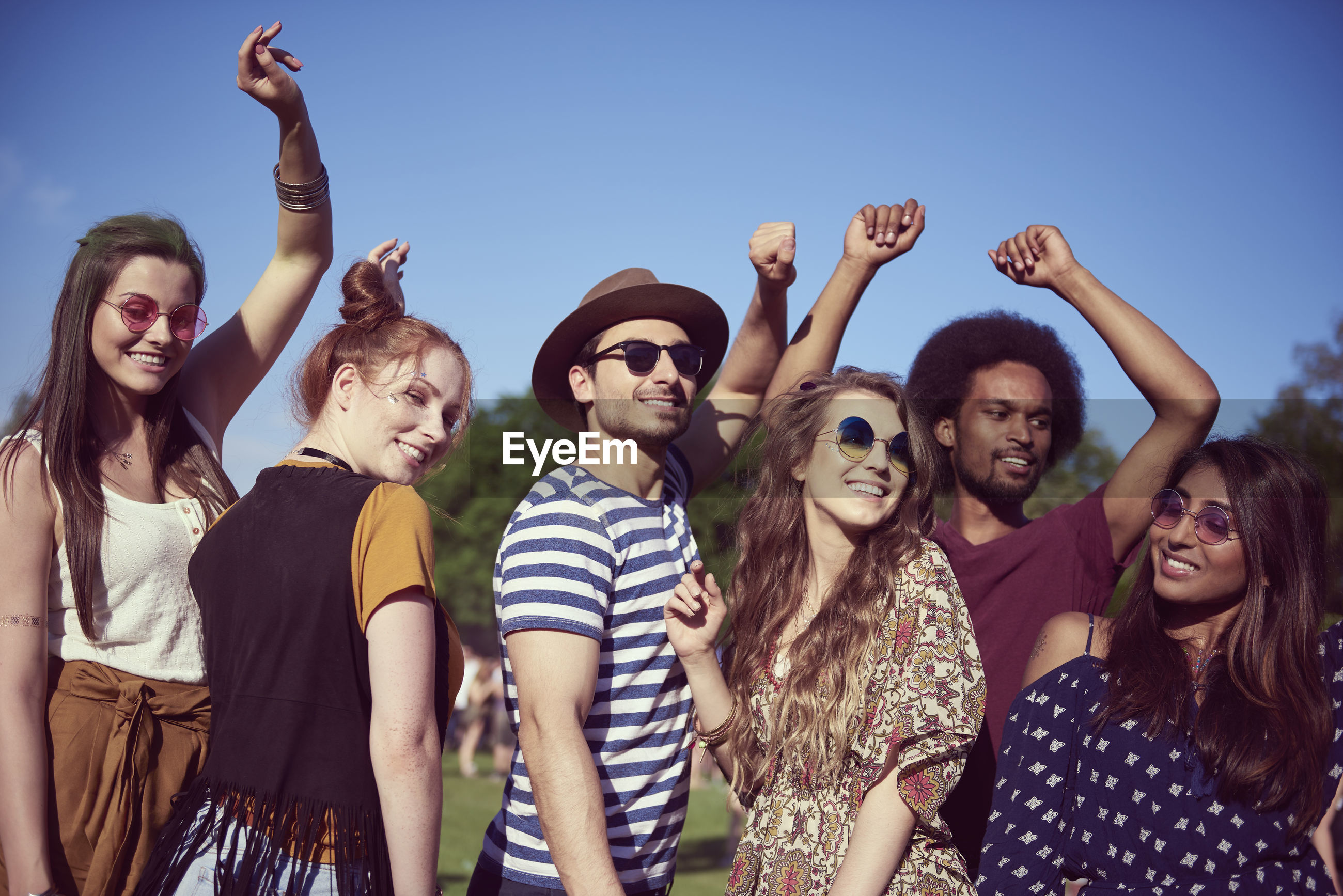 Group of people at party during sunny day