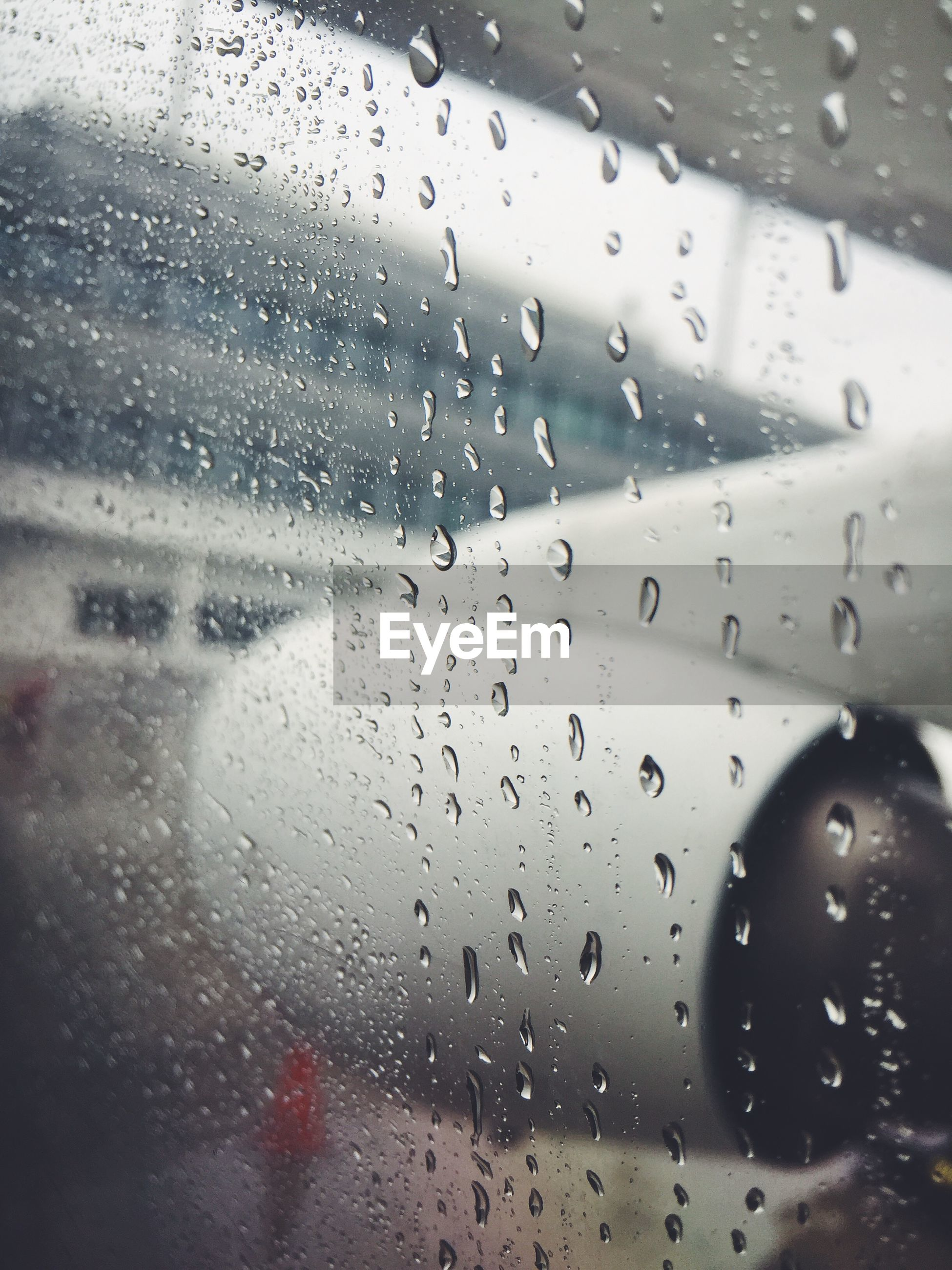 View of aircraft engine in rain