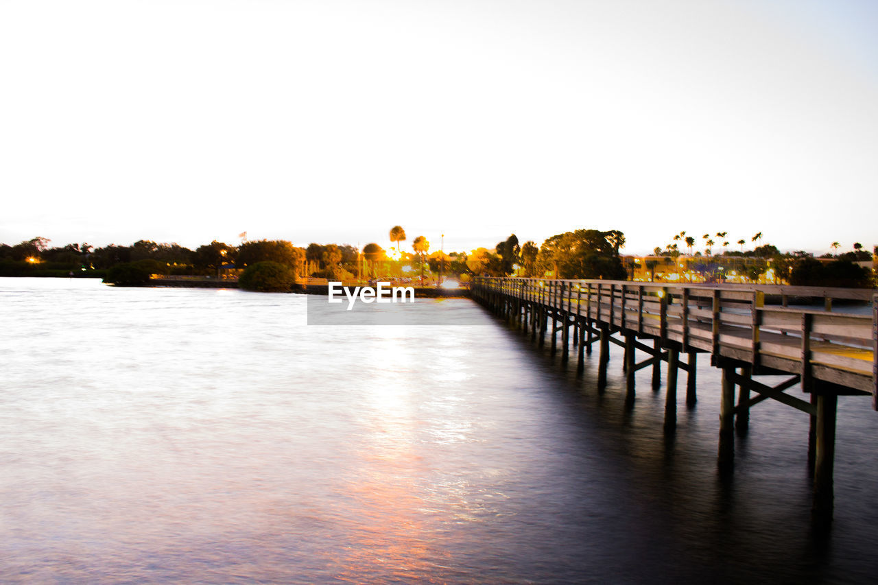 water, copy space, river, clear sky, outdoors, no people, built structure, waterfront, architecture, sunset, nature, scenics, beauty in nature, sky, day