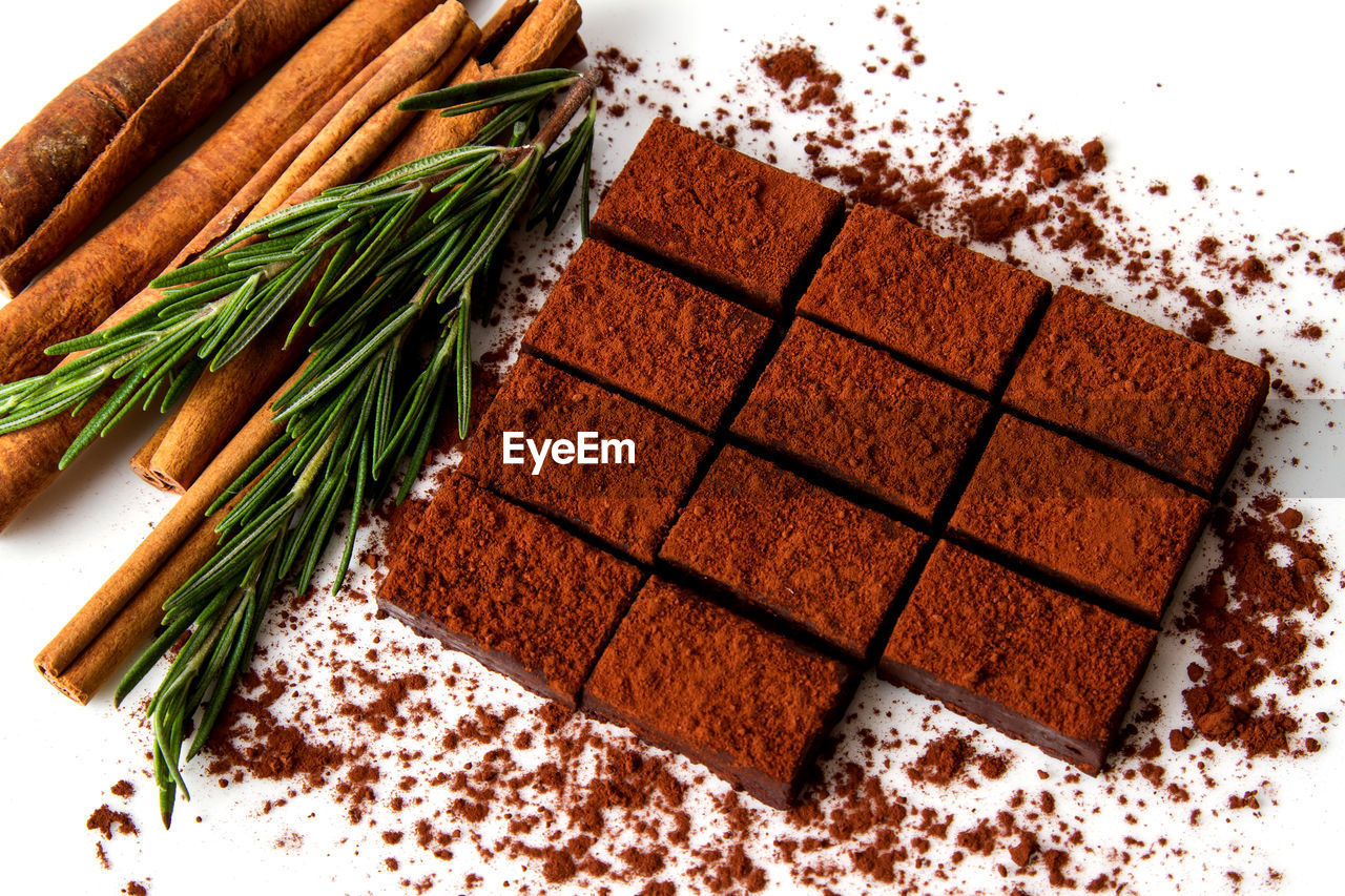 food and drink, food, freshness, indoors, table, chocolate, no people, sweet food, close-up, still life, brown, ingredient, high angle view, spice, baked, healthy eating, indulgence, drink, herb, coffee - drink, temptation