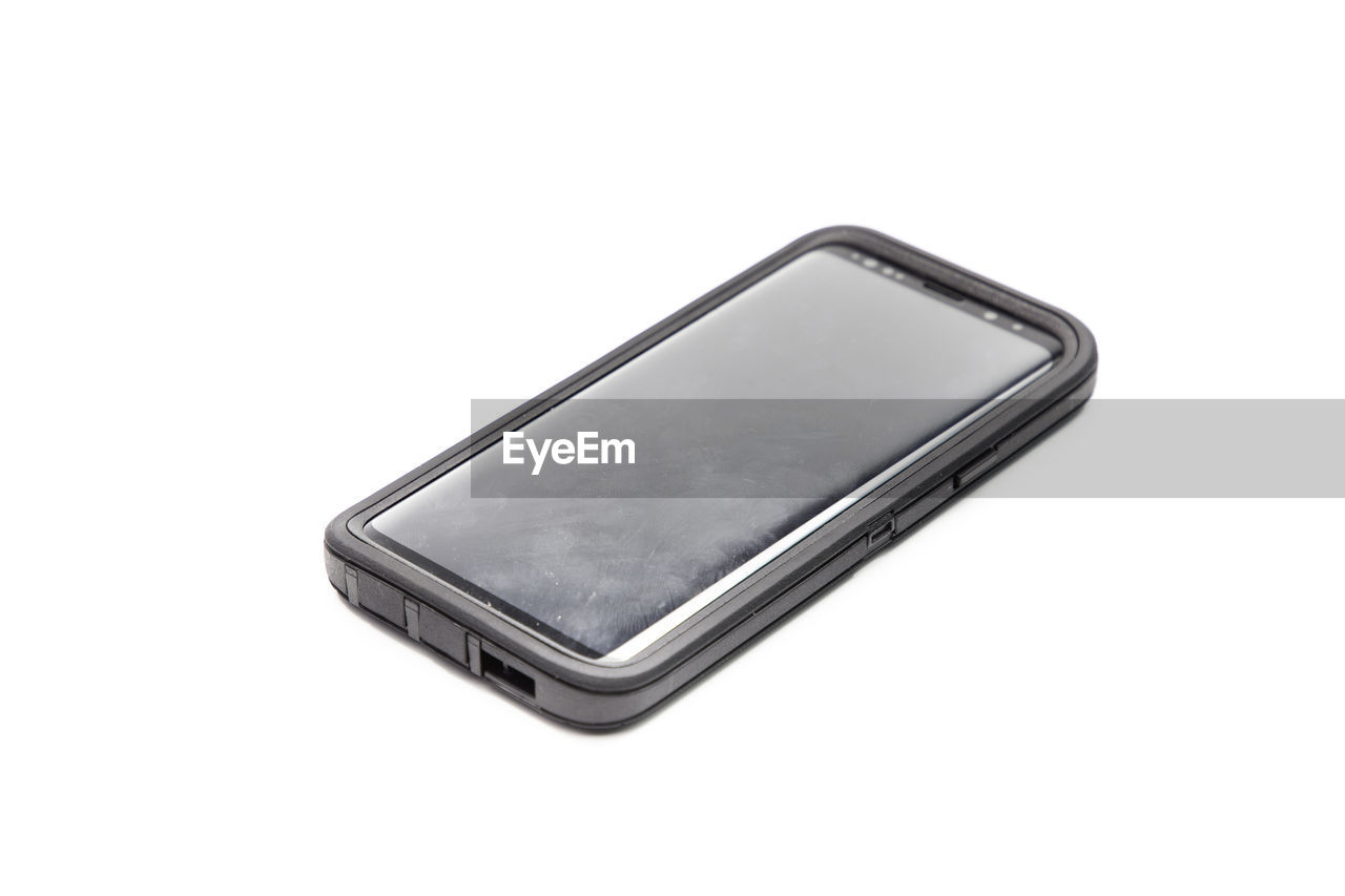 High angle view of smart phone against white background