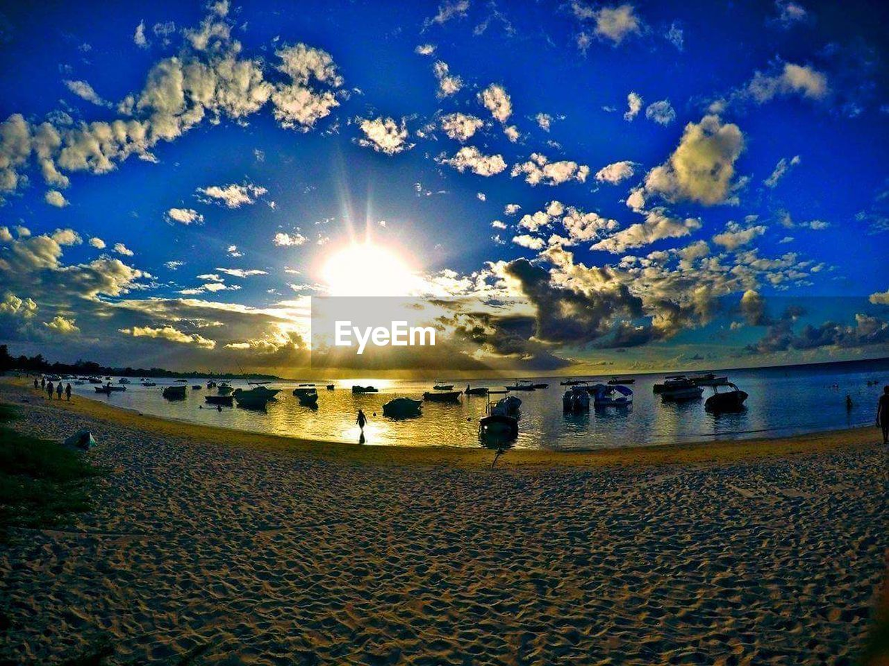 beach, sun, sky, lens flare, sunlight, sand, sunbeam, nature, sunset, sea, outdoors, water, vacations, scenics, horizon over water, beauty in nature, no people, day