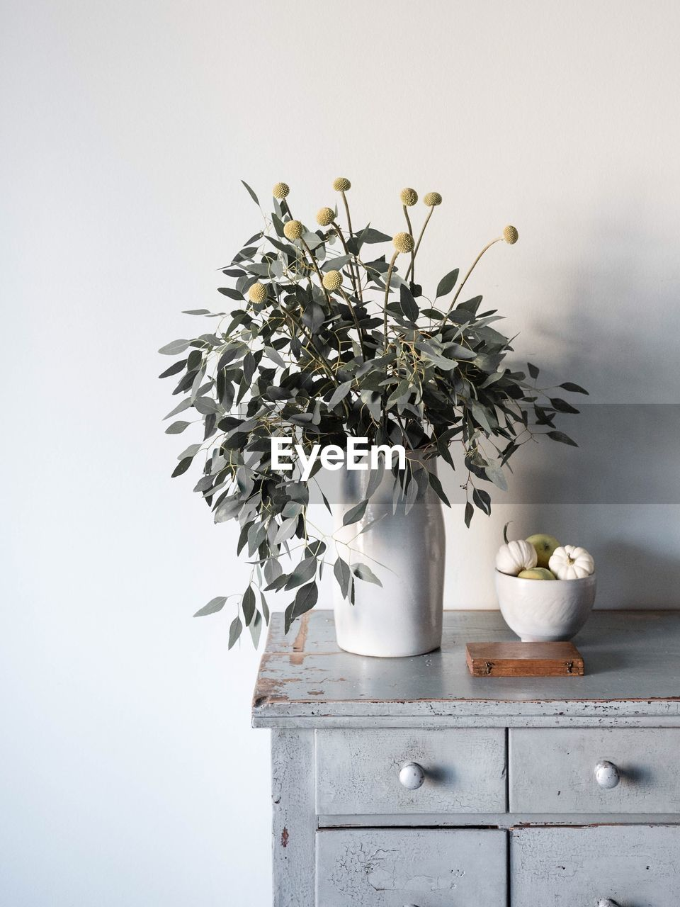 High Angle View Of Flower Vase By Food In Bowl On Table