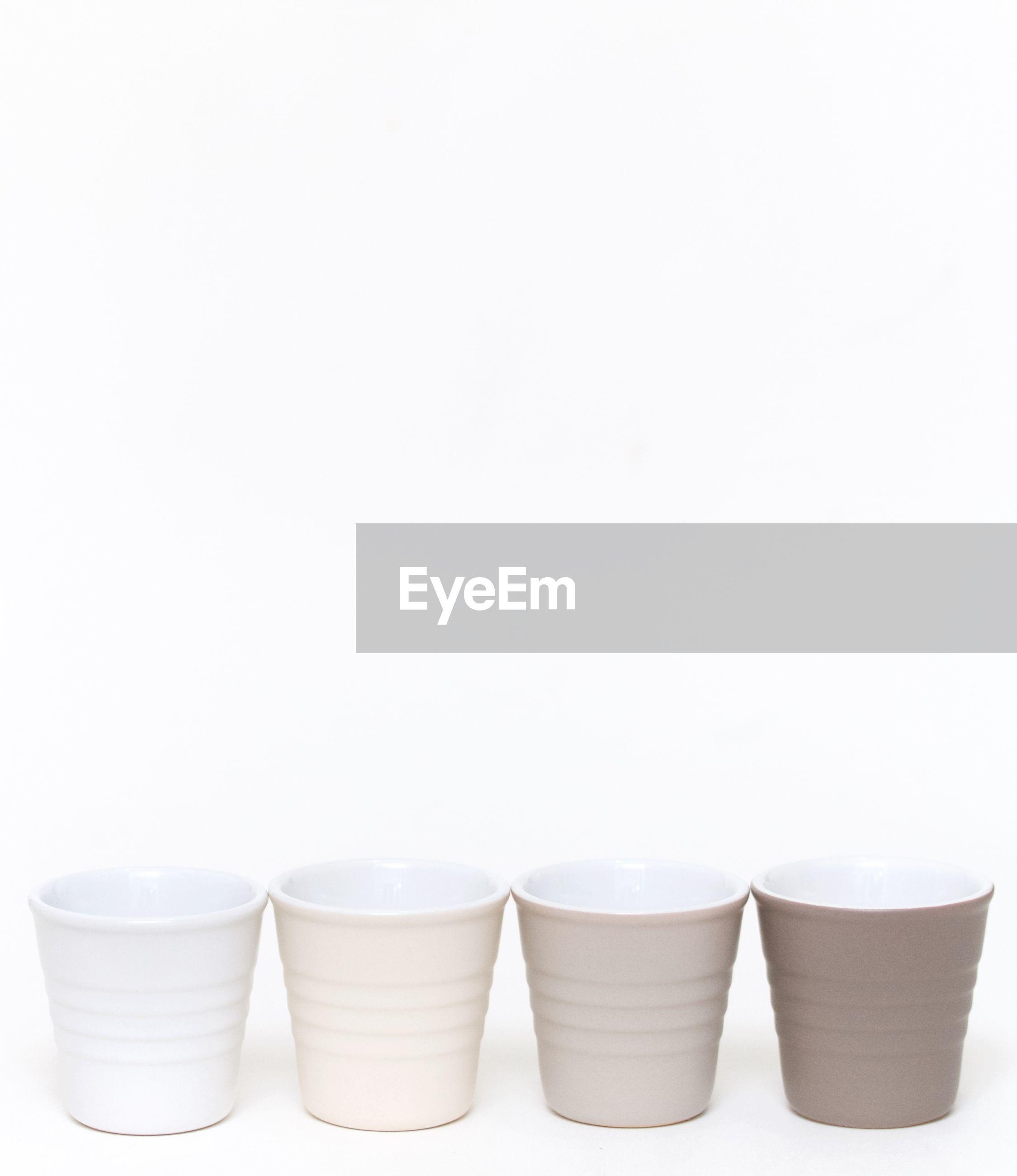 Empty glasses against white background