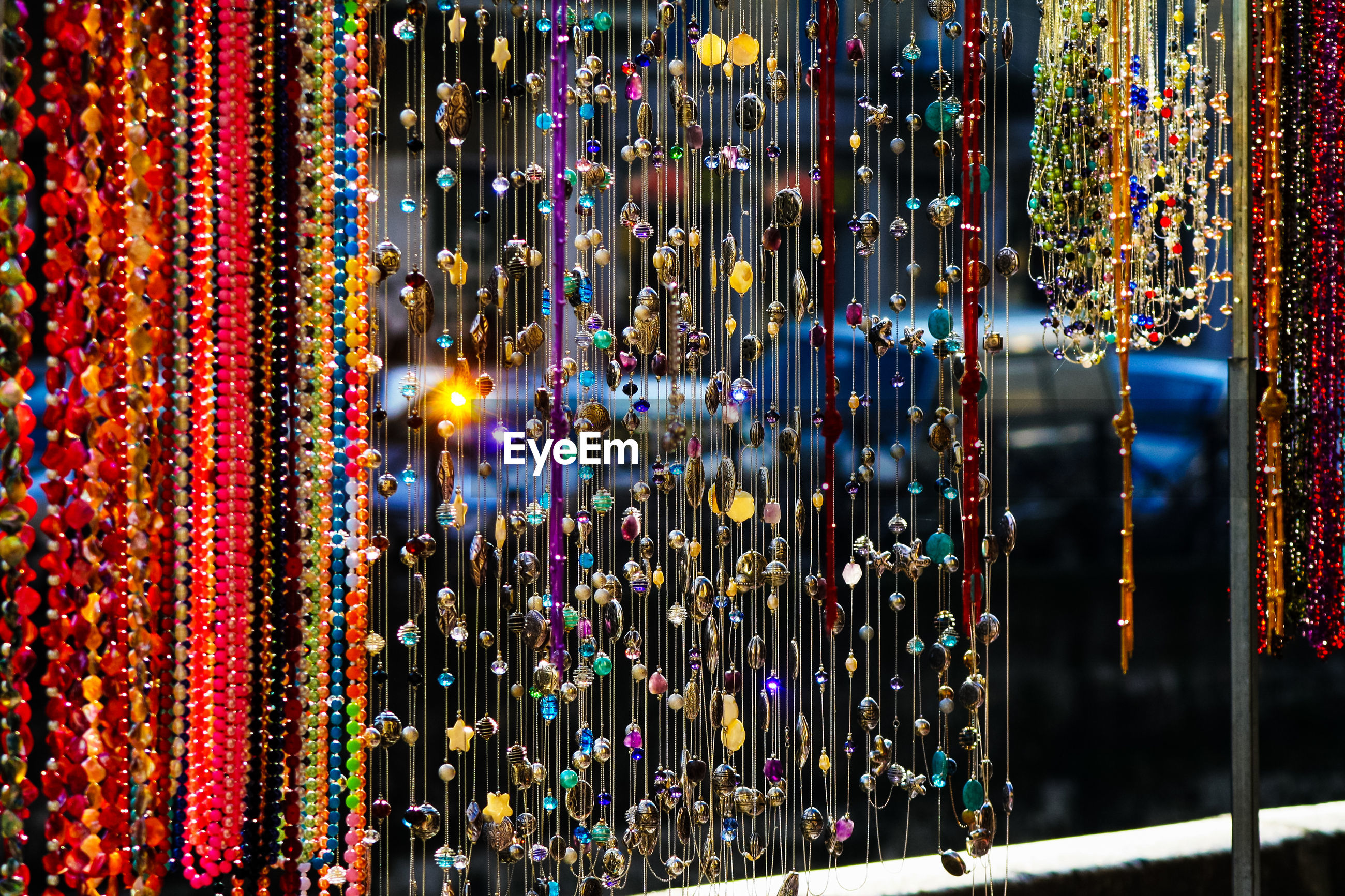 Close-up of multi colored decoration for sale at market stall