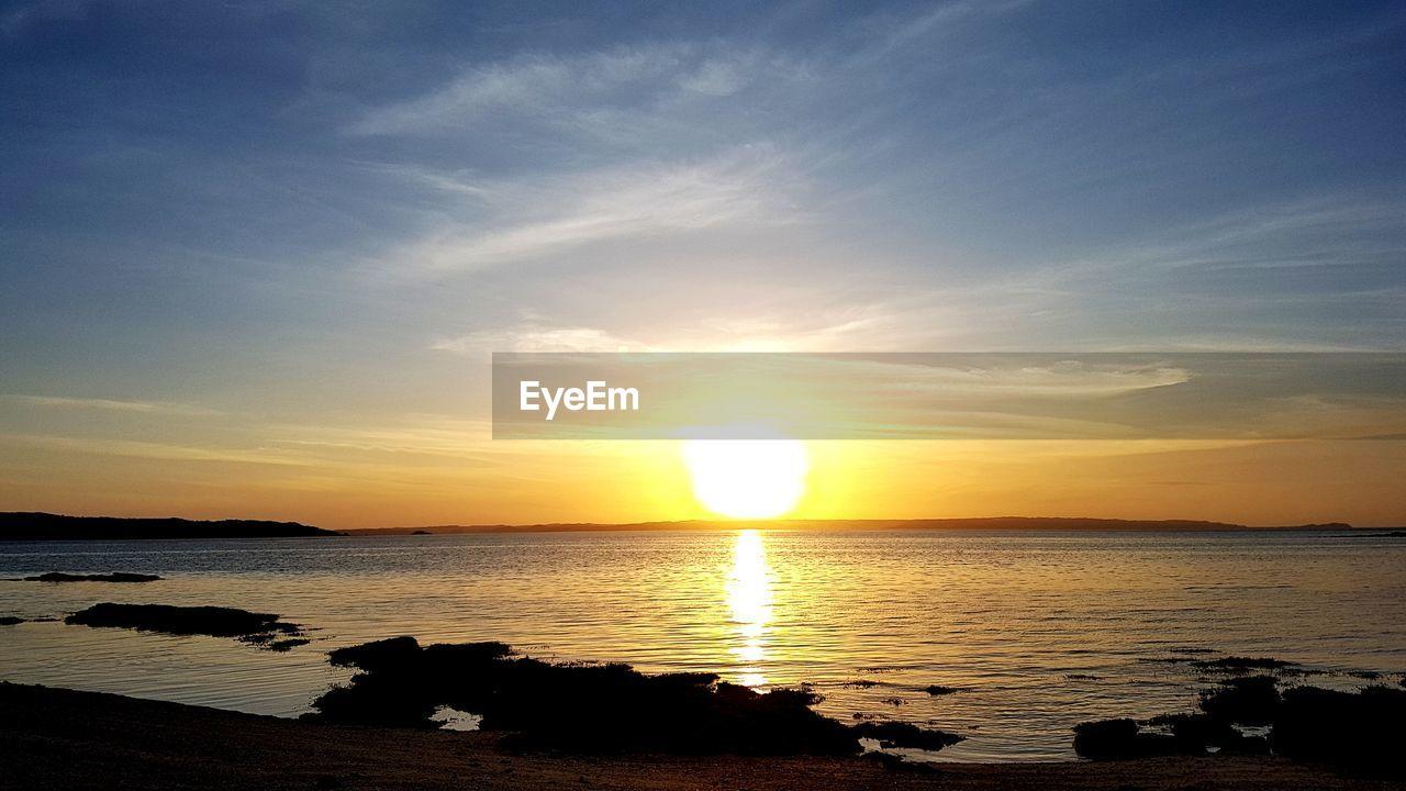 sky, water, sunset, scenics - nature, beauty in nature, sea, tranquility, tranquil scene, reflection, sun, cloud - sky, sunlight, land, idyllic, nature, beach, horizon, orange color, non-urban scene, no people, horizon over water, outdoors