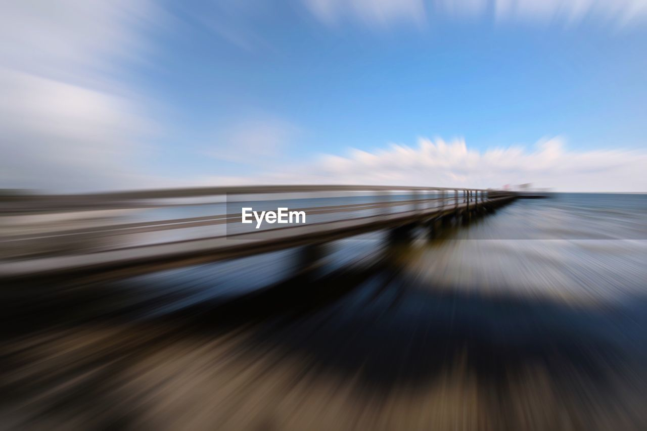Blurred Motion Of Pier Against Sky At Beach