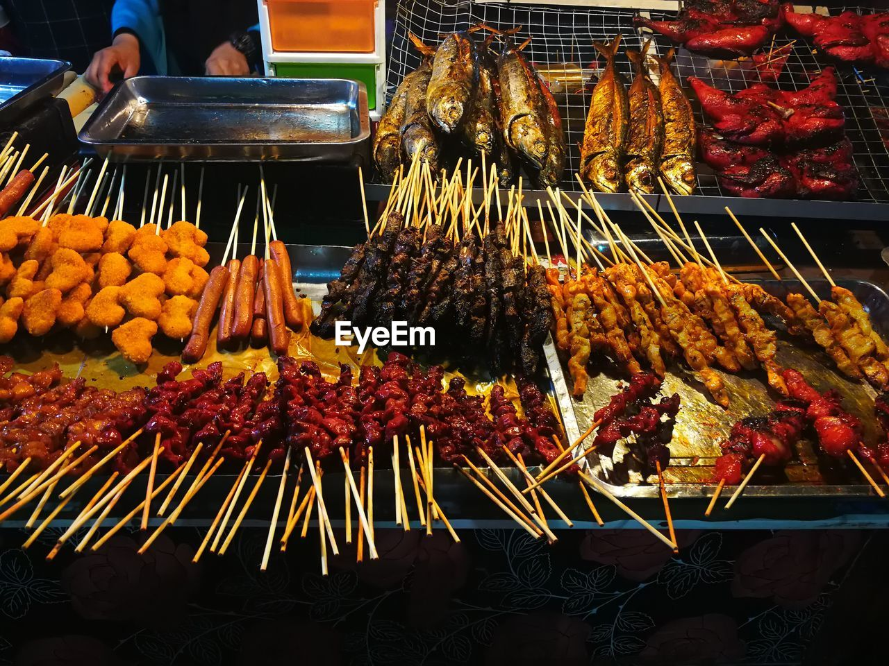 food and drink, food, market, retail, freshness, meat, skewer, abundance, for sale, large group of objects, choice, market stall, incidental people, variation, real people, barbecue, night, arrangement, high angle view, sale, street food