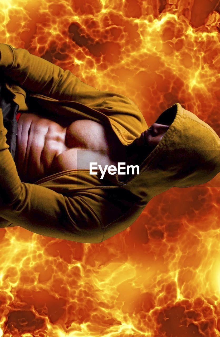 Man against fiery background