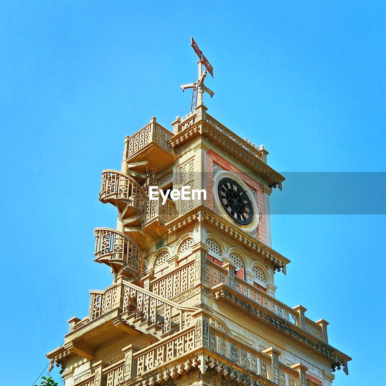 low angle view, architecture, building exterior, built structure, clear sky, day, blue, outdoors, history, no people, statue, sky, sculpture, clock tower, clock