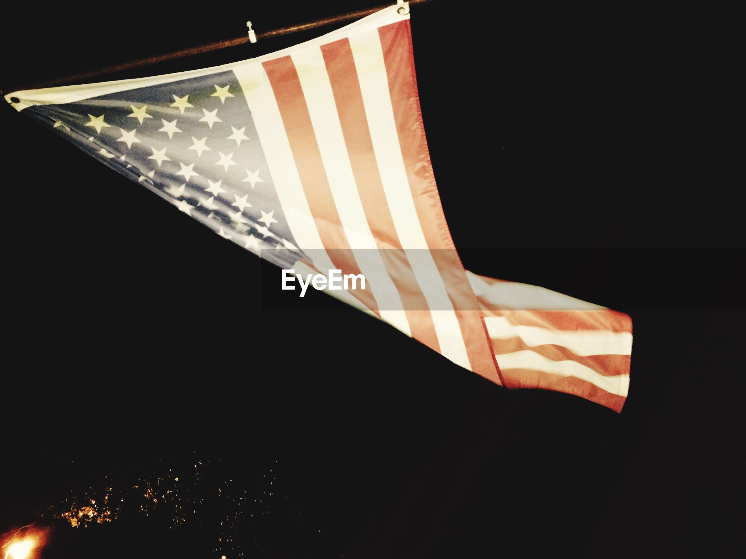 Low angle view of american flag against sky at night