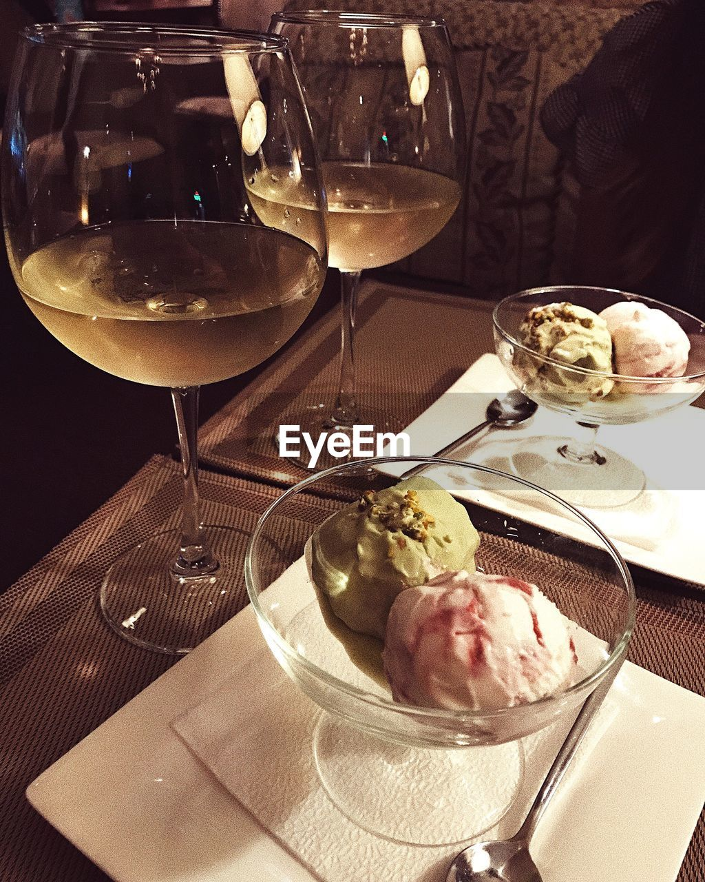 food and drink, table, food, plate, freshness, indulgence, serving size, refreshment, indoors, sweet food, dessert, ready-to-eat, restaurant, wineglass, temptation, fork, ice cream, drink, meal, drinking glass, frozen food, no people, healthy eating, appetizer, close-up, day