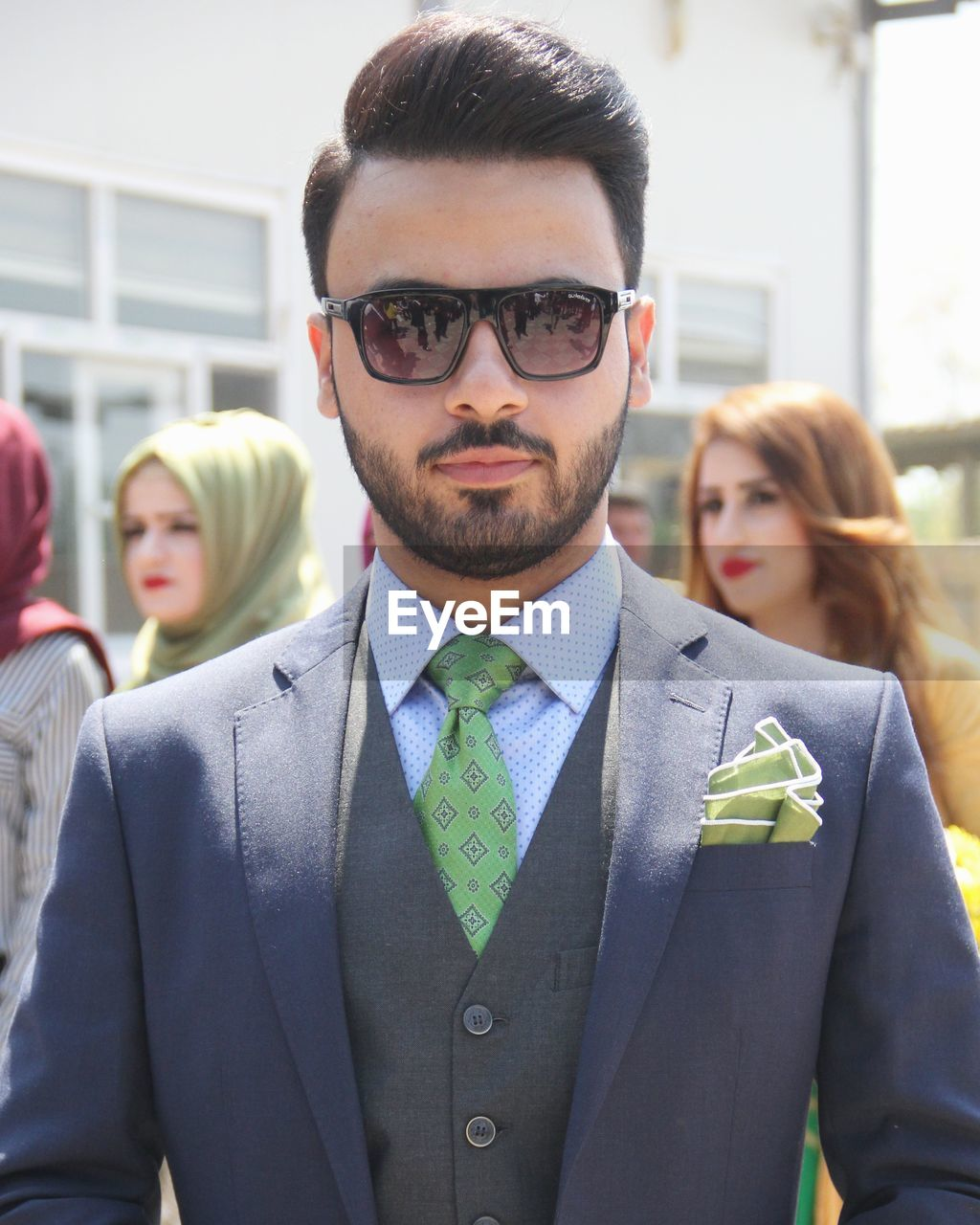 real people, front view, mid adult men, mid adult, young adult, young men, lifestyles, focus on foreground, headshot, two people, standing, well-dressed, young women, day, eyeglasses, close-up, looking at camera, men, indoors, people