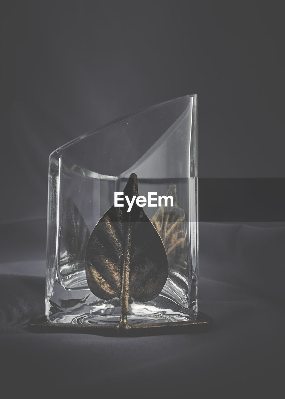 transparent, glass - material, studio shot, indoors, close-up, no people, still life, glass, black background, nature, table, drinking glass, household equipment, water, gray, copy space, container, shape, design, purity