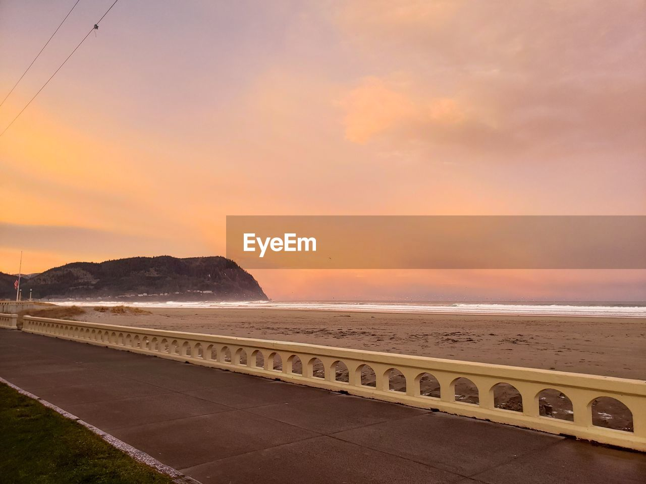 sky, sunset, water, sea, beauty in nature, scenics - nature, cloud - sky, nature, land, tranquility, tranquil scene, orange color, beach, no people, mountain, transportation, road, horizon over water, idyllic, outdoors