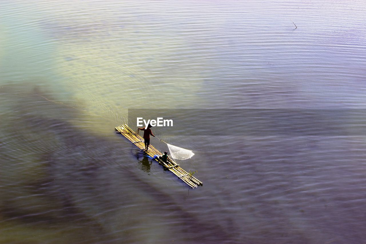 High angle view of people on boat fishing
