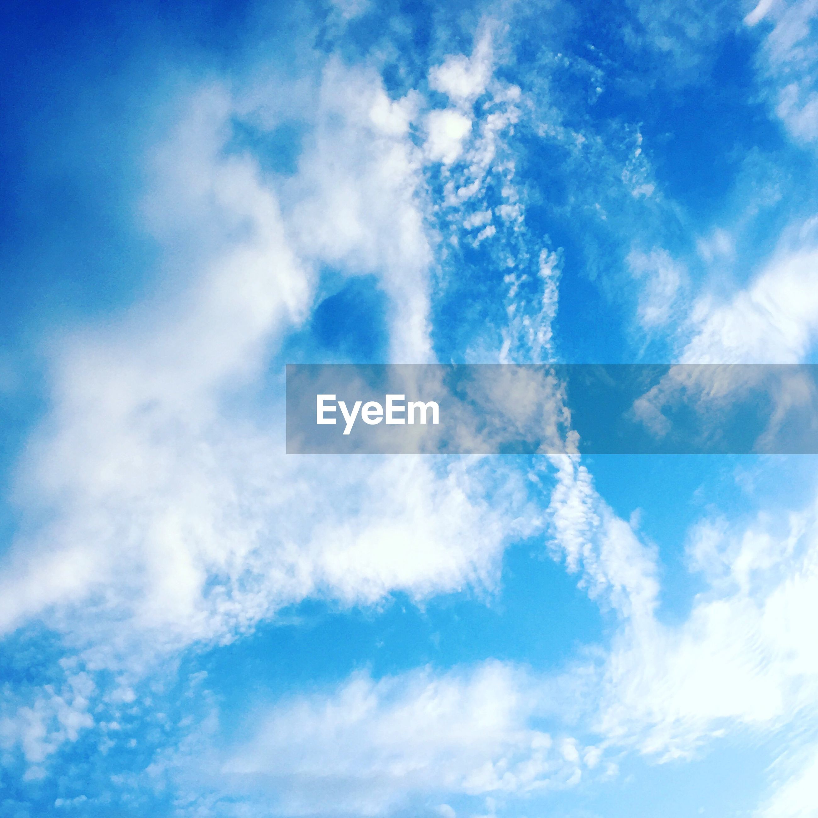 blue, sky, low angle view, sky only, beauty in nature, tranquility, cloud - sky, scenics, backgrounds, nature, tranquil scene, full frame, cloudscape, cloud, idyllic, cloudy, day, outdoors, no people, majestic, white, softness
