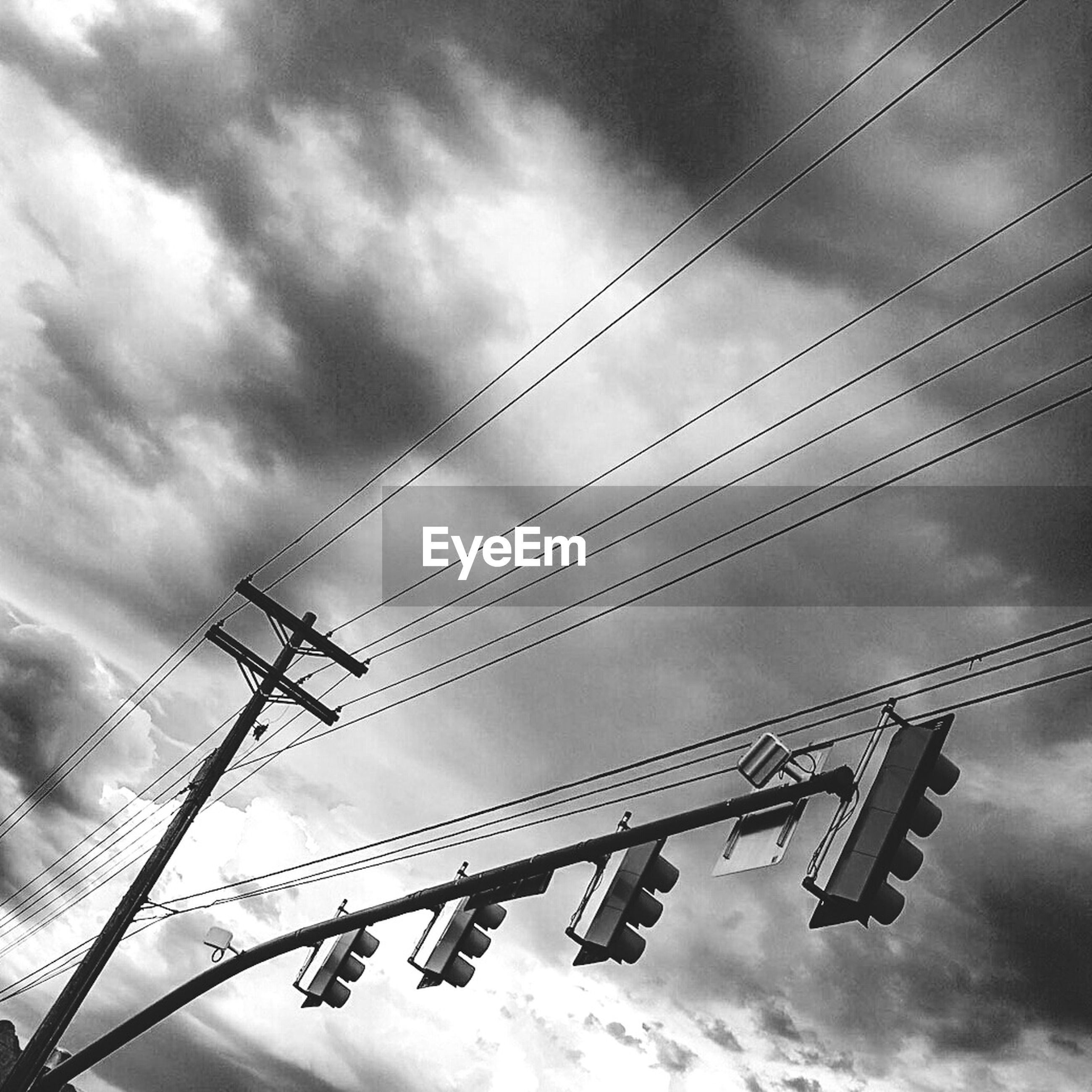 low angle view, sky, cloud - sky, power line, cloudy, cable, electricity, connection, power supply, electricity pylon, fuel and power generation, cloud, built structure, technology, day, outdoors, architecture, no people, power cable, weather