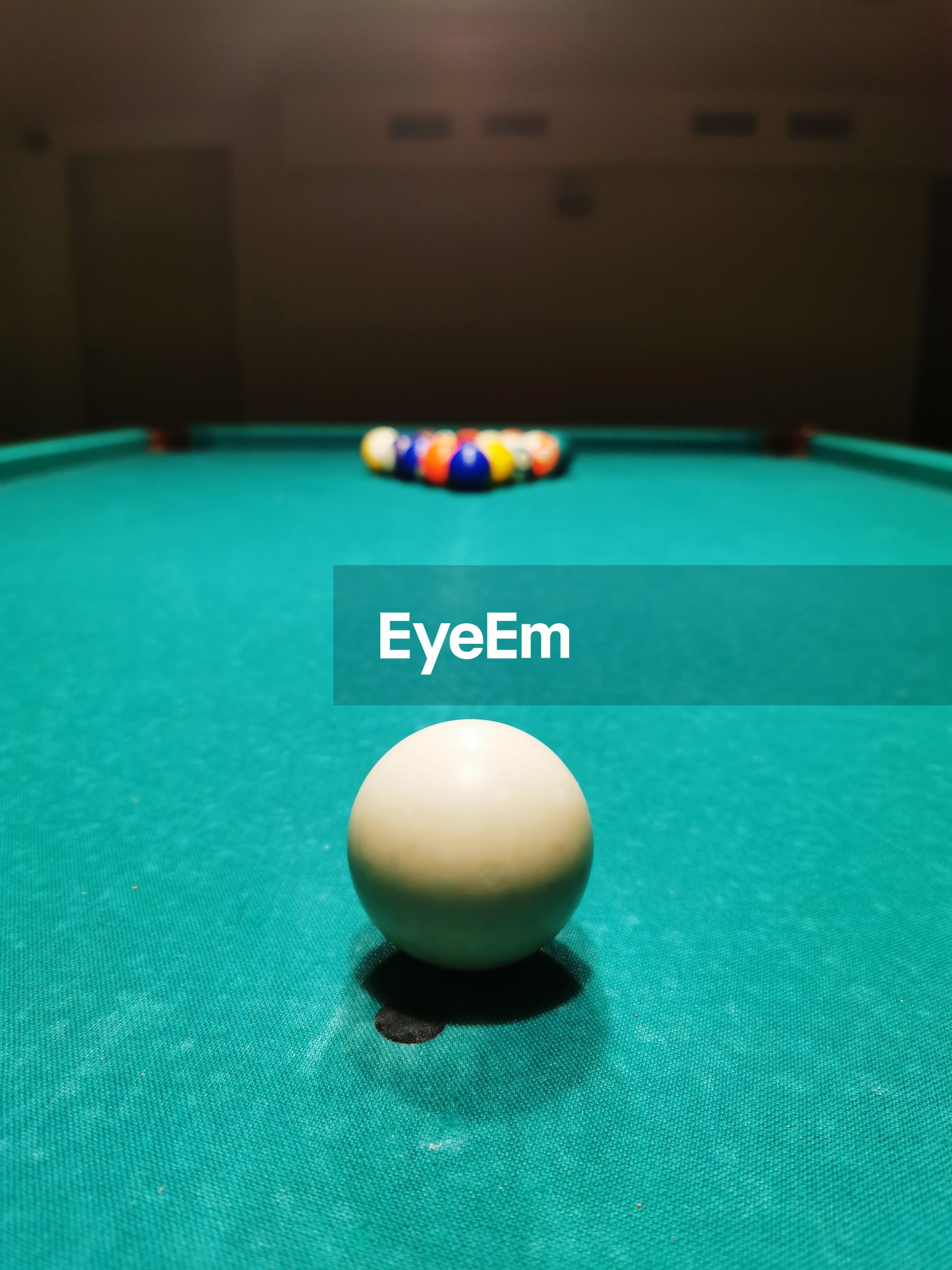 Close-up of ball on table, snooker game