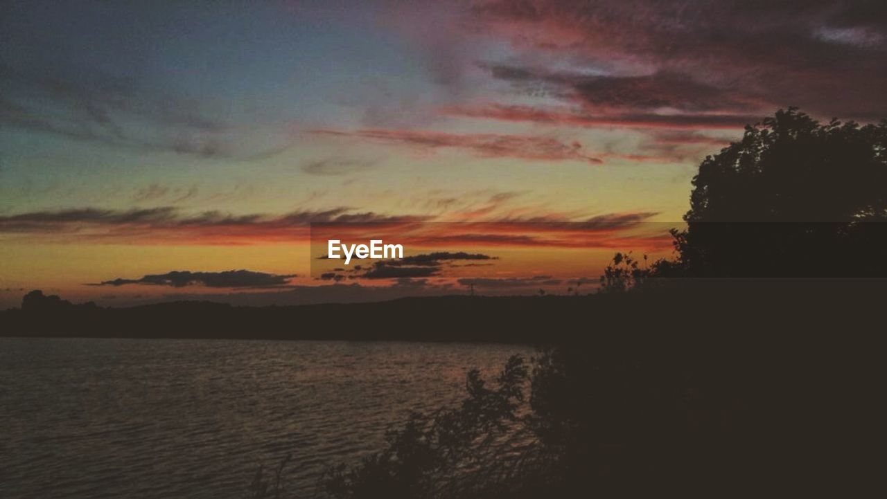 sunset, scenics, beauty in nature, tranquil scene, sky, nature, tranquility, silhouette, cloud - sky, no people, water, outdoors, tree, landscape