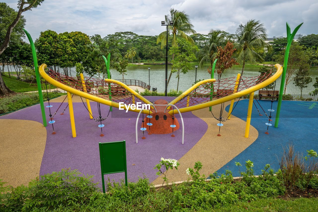 plant, tree, sky, cloud - sky, nature, day, water, playground, childhood, park, growth, outdoors, land, grass, beauty in nature, slide, park - man made space, tranquility, outdoor play equipment