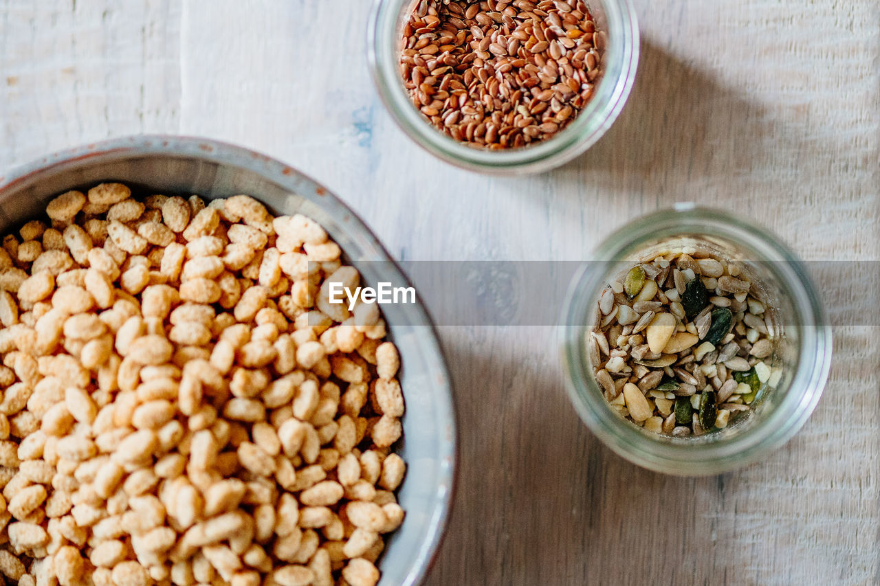 food and drink, food, wellbeing, healthy eating, bowl, freshness, high angle view, table, indoors, no people, seed, still life, close-up, container, kitchen utensil, nut, dried food, raw food, cereal plant, breakfast