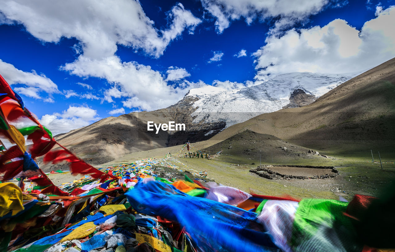 Colorful Fabrics By Mountains Against Sky