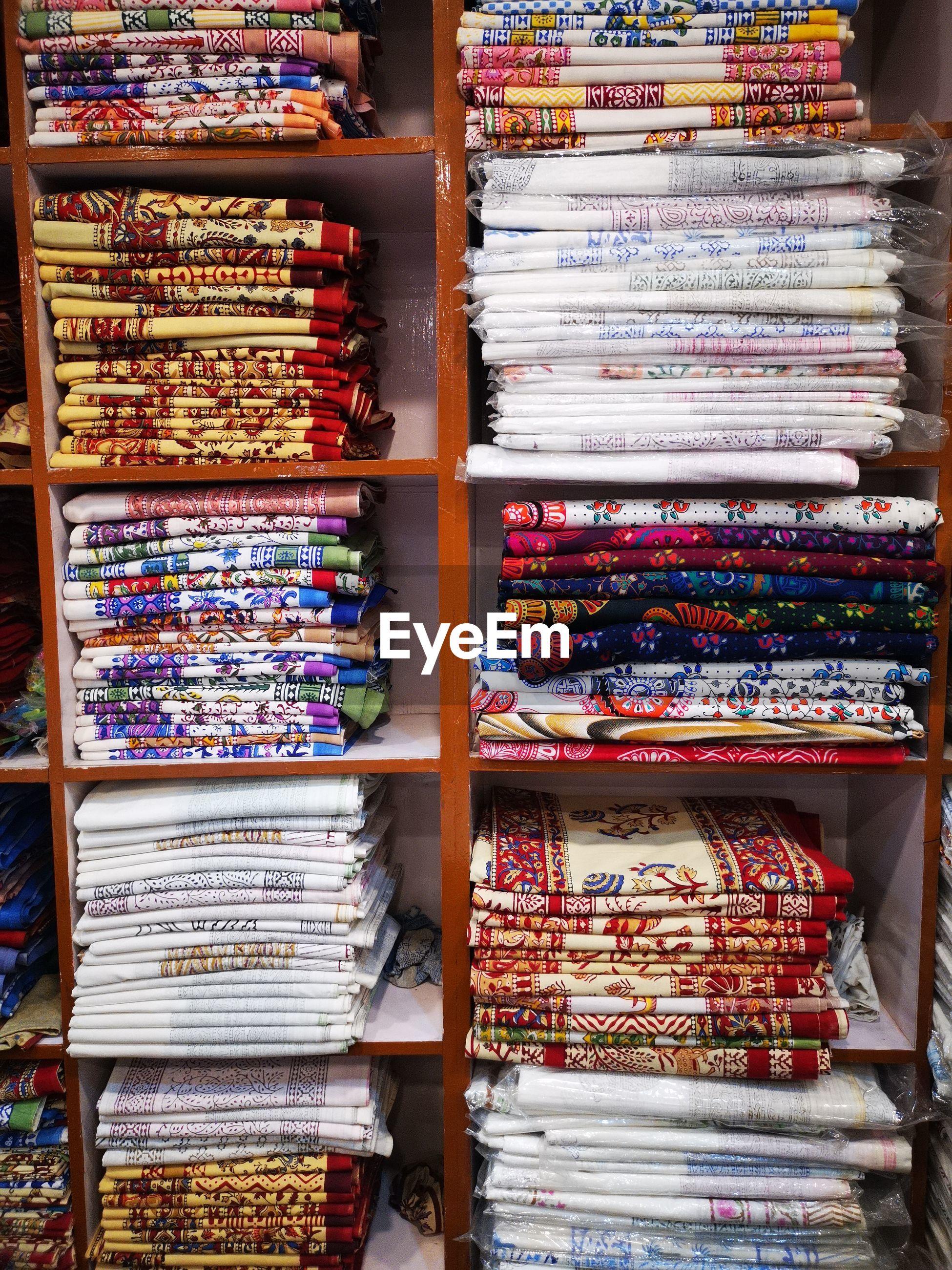 Stack of fabrics on shelf at store