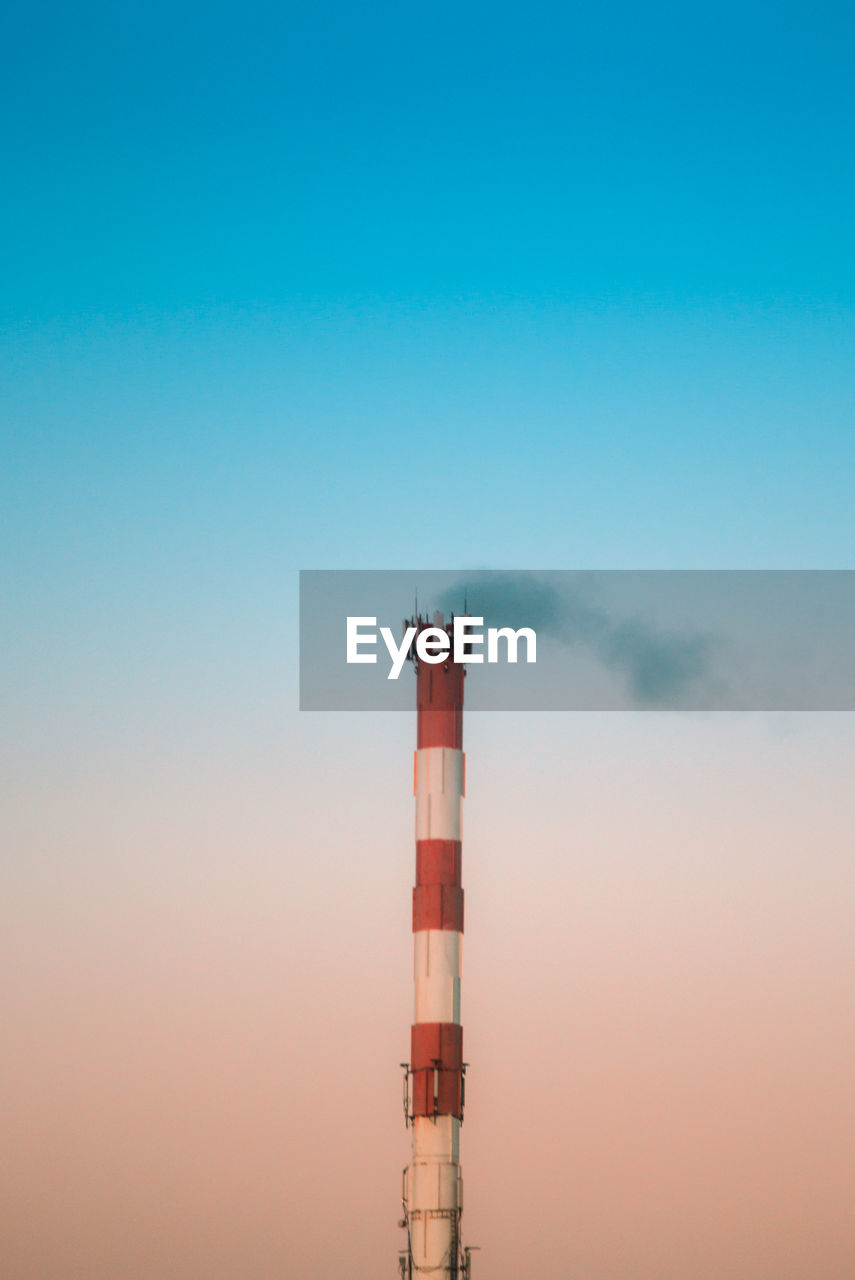 Smoke Stack Against Clear Sky
