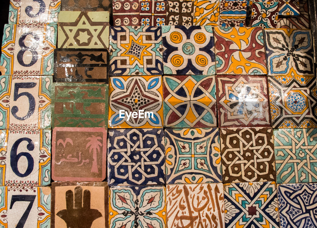 multi colored, full frame, pattern, backgrounds, art and craft, creativity, design, no people, craft, close-up, indoors, tile, wall - building feature, mosaic, flooring, floral pattern, architecture, religion, built structure, variation, tiled floor, ornate