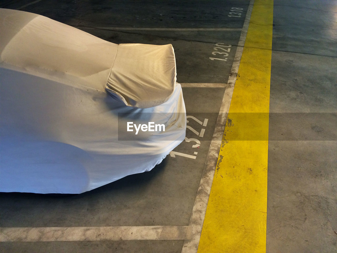 High angle view of covered car on parking lot