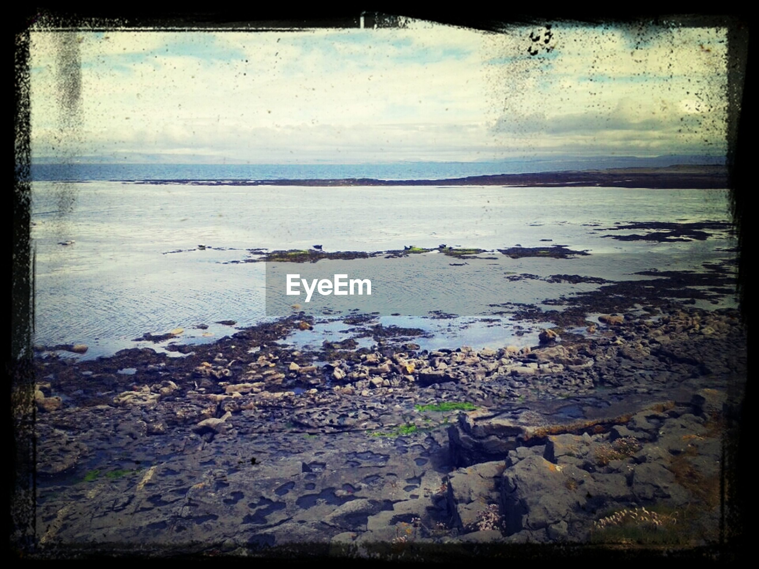transfer print, water, auto post production filter, sky, tranquility, tranquil scene, sea, nature, scenics, beauty in nature, beach, shore, horizon over water, rock - object, cloud - sky, lake, no people, outdoors, day, cloud