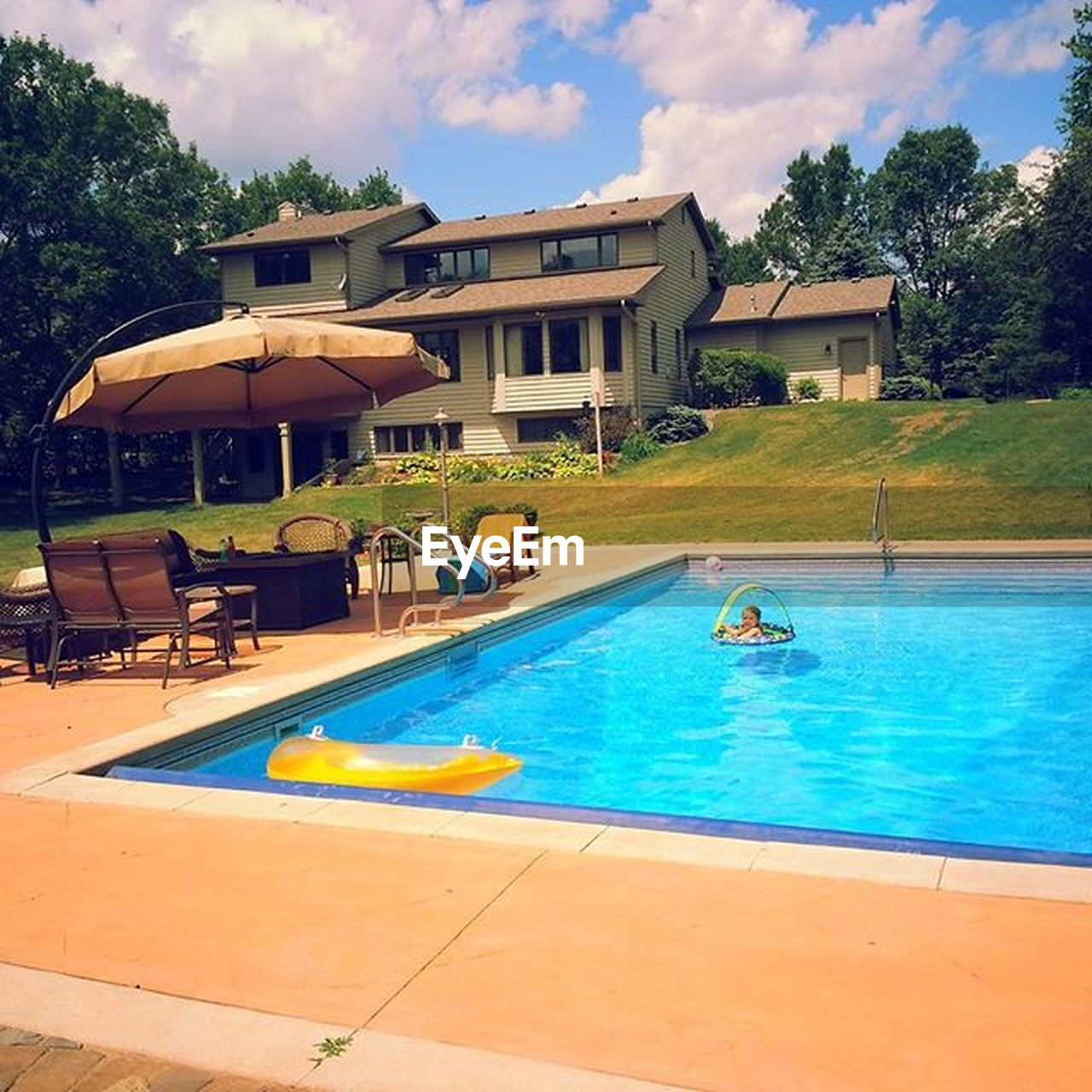 swimming pool, water, poolside, architecture, tourist resort, building exterior, vacations, day, luxury, outdoors, tree, summer, blue, sky, health spa, relaxation, holiday villa, nature, no people, swimming