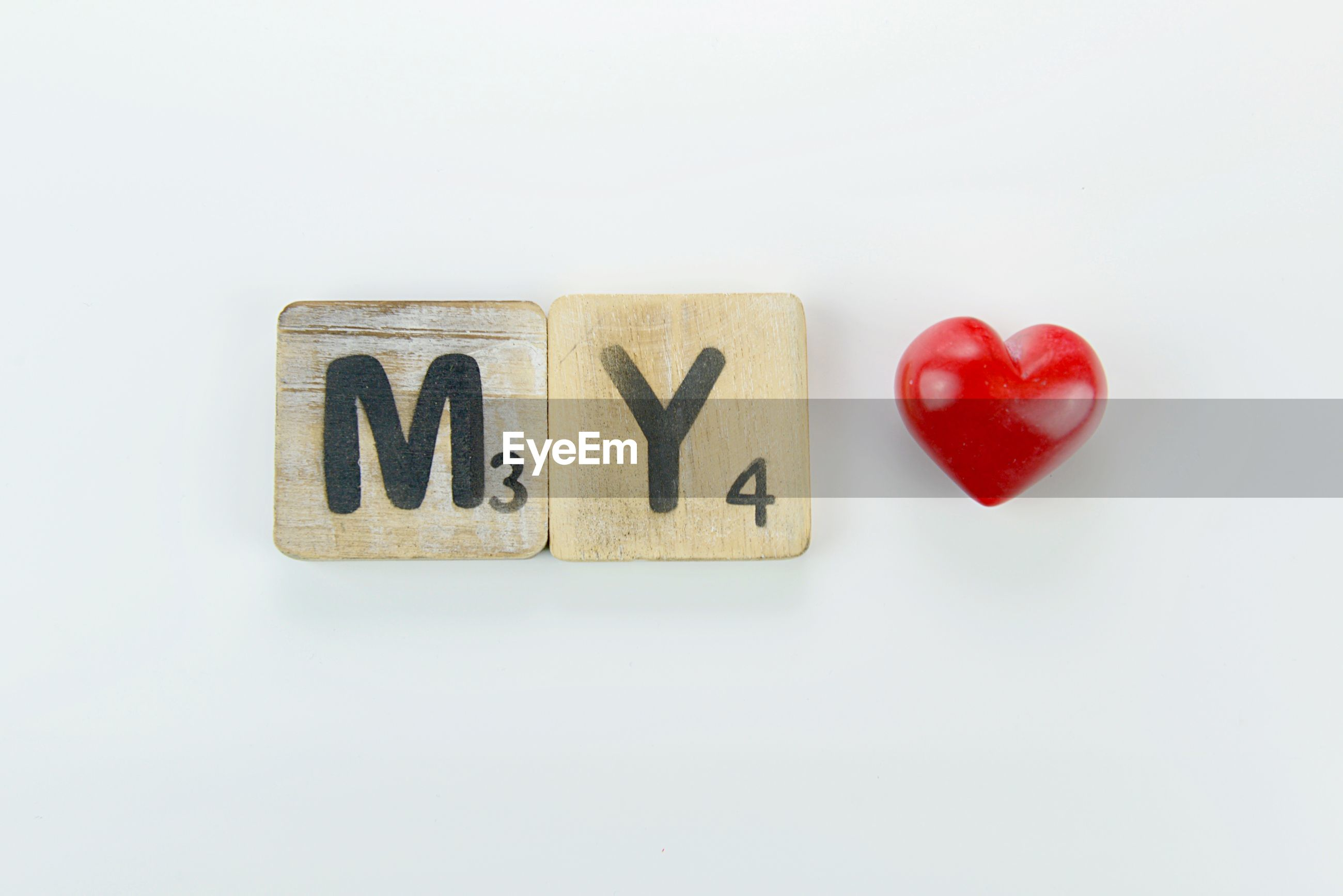 Close-up of text on toy blocks over white background