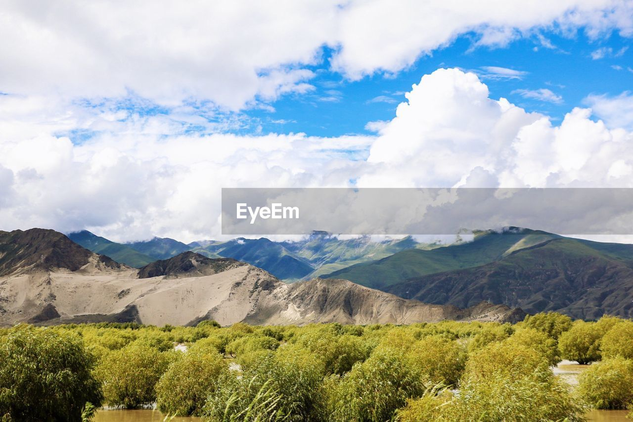cloud - sky, sky, scenics - nature, mountain, beauty in nature, tranquil scene, tranquility, landscape, environment, plant, non-urban scene, nature, day, land, mountain range, no people, tree, idyllic, green color, remote, outdoors