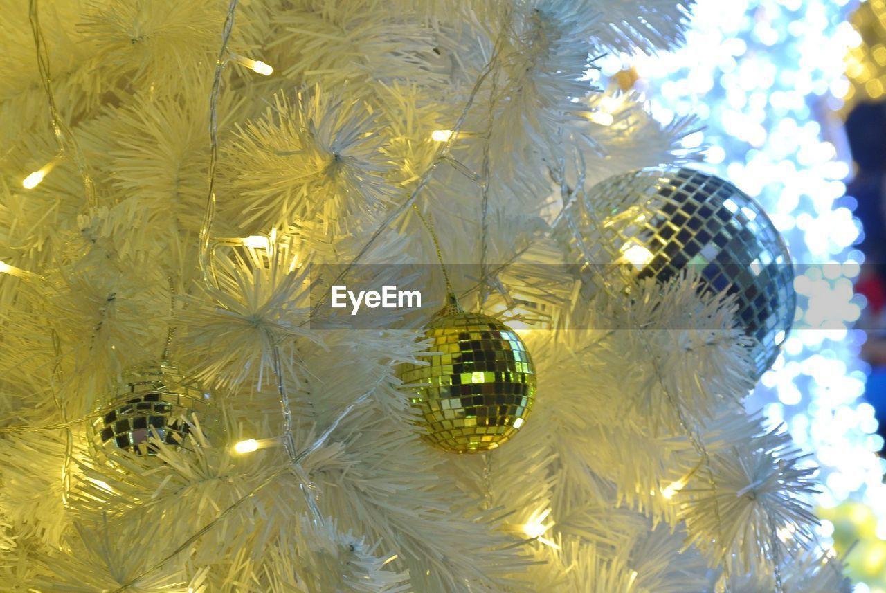celebration, decoration, christmas decoration, hanging, close-up, christmas ornament, christmas, no people, christmas tree, illuminated, bauble, christmas lights, low angle view, night, indoors