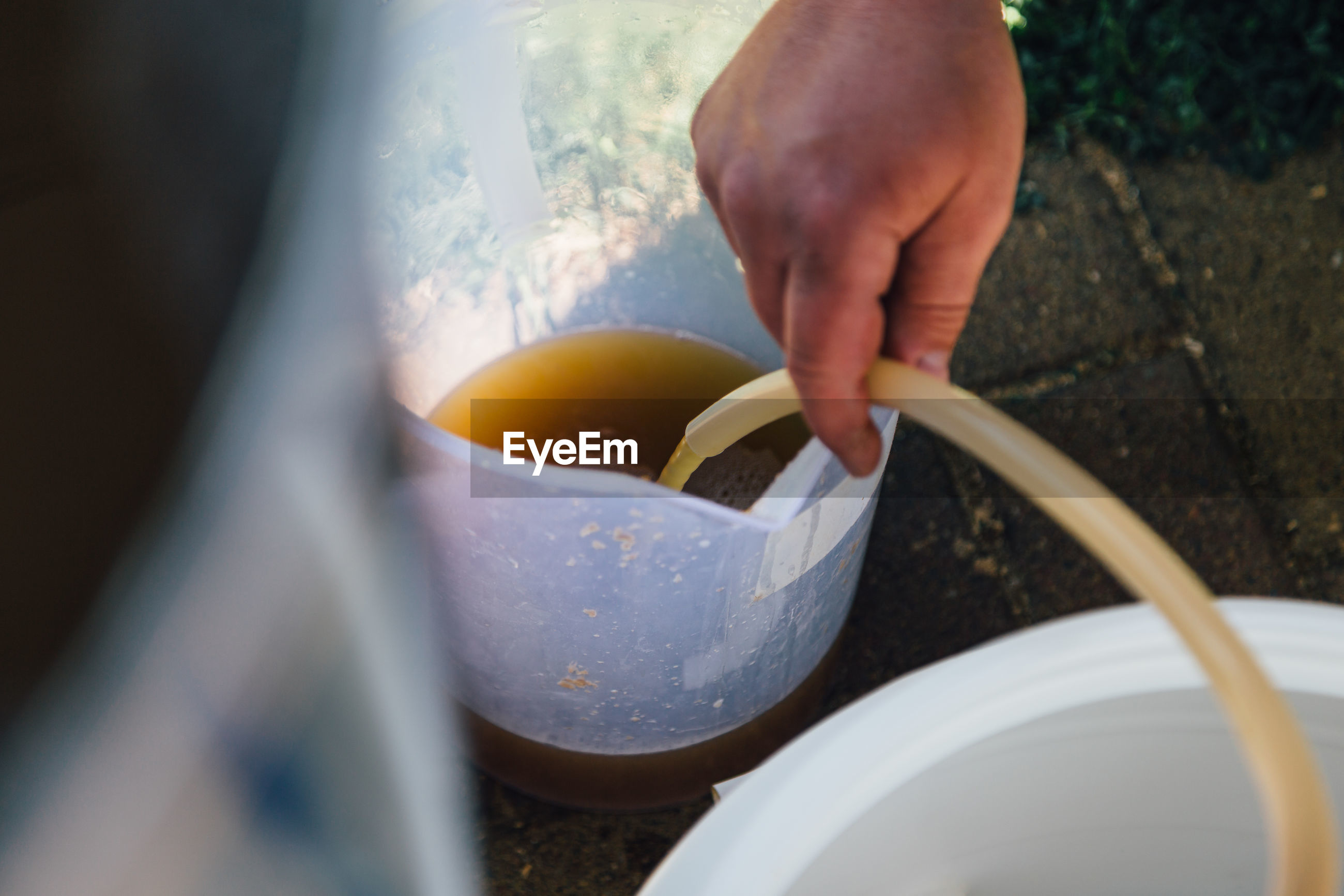 Midsection of person preparing food in bowl