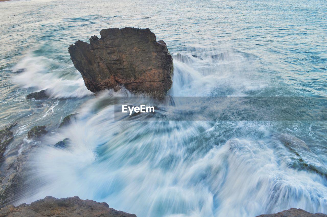 Headland in calm sea