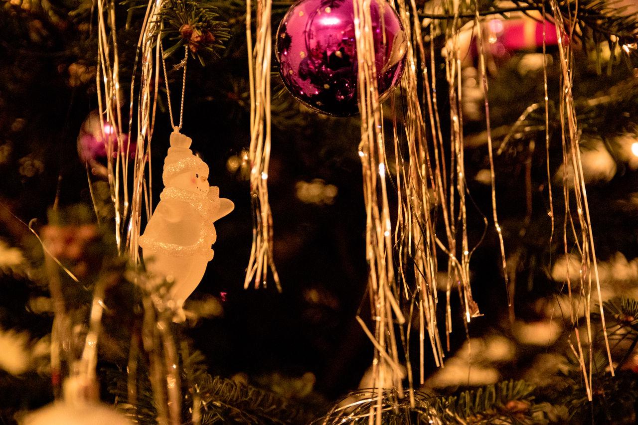 decoration, christmas decoration, holiday, christmas, celebration, no people, close-up, christmas ornament, illuminated, selective focus, night, tree, christmas tree, christmas lights, nature, plant, outdoors, holiday - event, focus on foreground