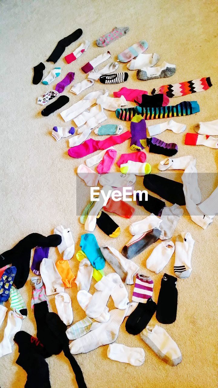 variation, high angle view, multi colored, indoors, large group of objects, choice, paper, no people, crumpled paper, day