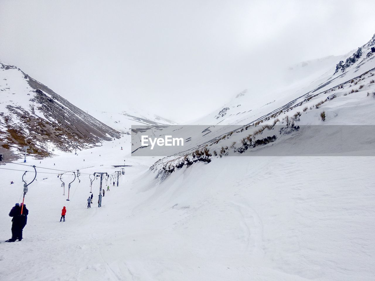 snow, winter, cold temperature, mountain, scenics - nature, sport, sky, winter sport, white color, beauty in nature, skiing, group of people, leisure activity, real people, nature, snowcapped mountain, day, adventure, tranquil scene, mountain range, outdoors