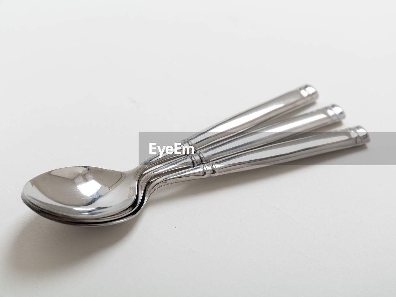 High angle view of spoons on white background