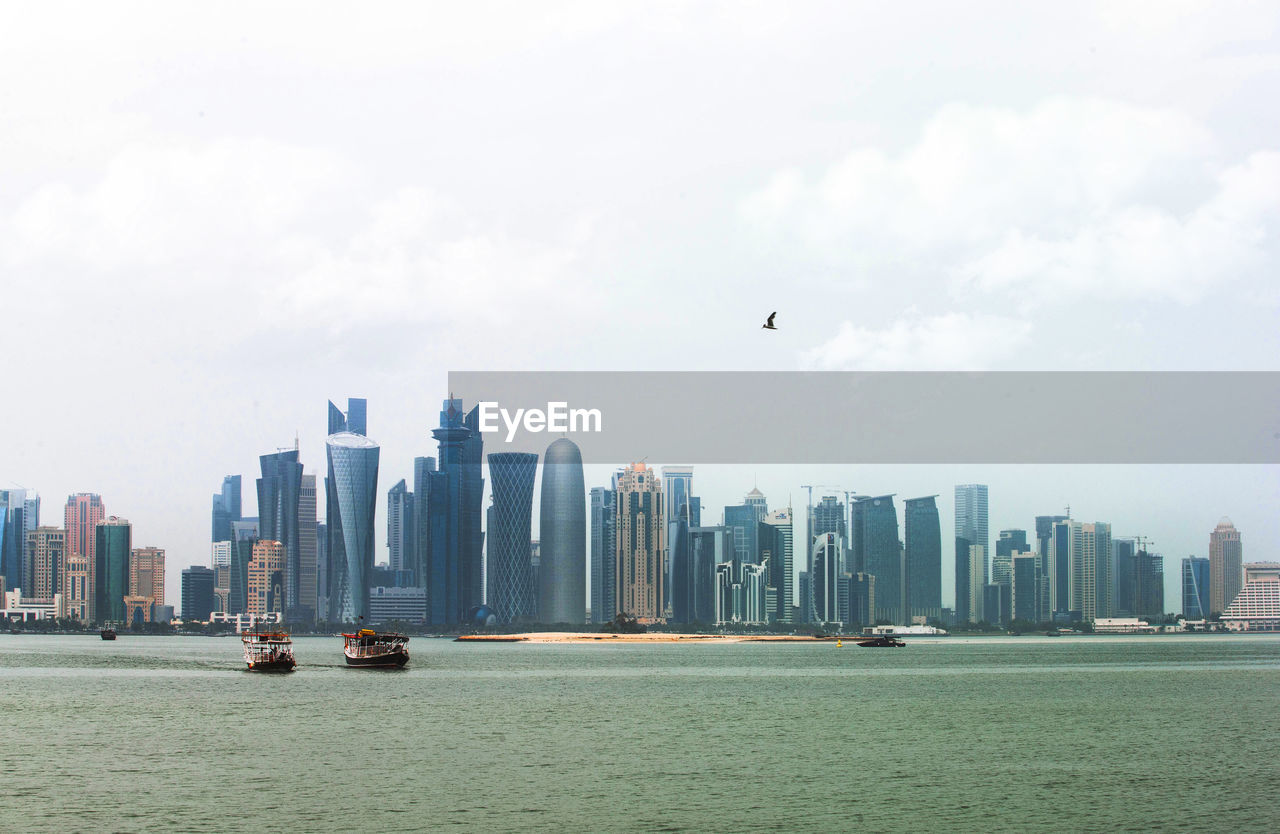 VIEW OF SKYSCRAPERS IN SEA