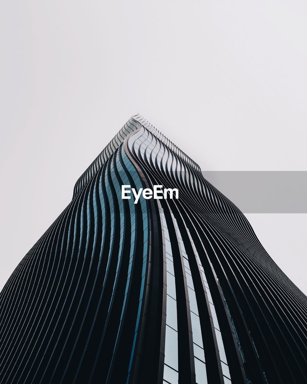 architecture, modern, low angle view, built structure, clear sky, building exterior, skyscraper, city, outdoors, no people, day, sky
