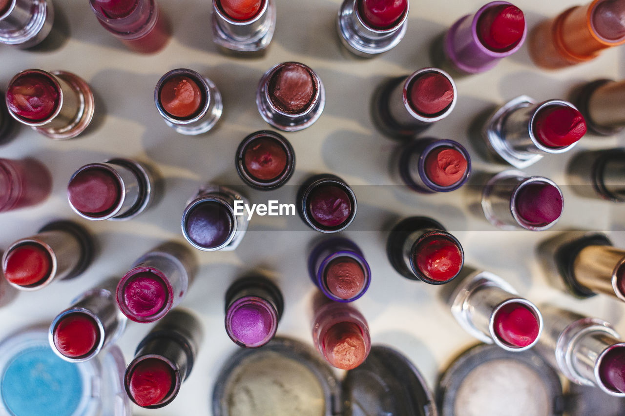 backgrounds, full frame, large group of objects, in a row, bottle, indoors, variation, high angle view, can, multi colored, no people, directly above, aerosol can, day, close-up