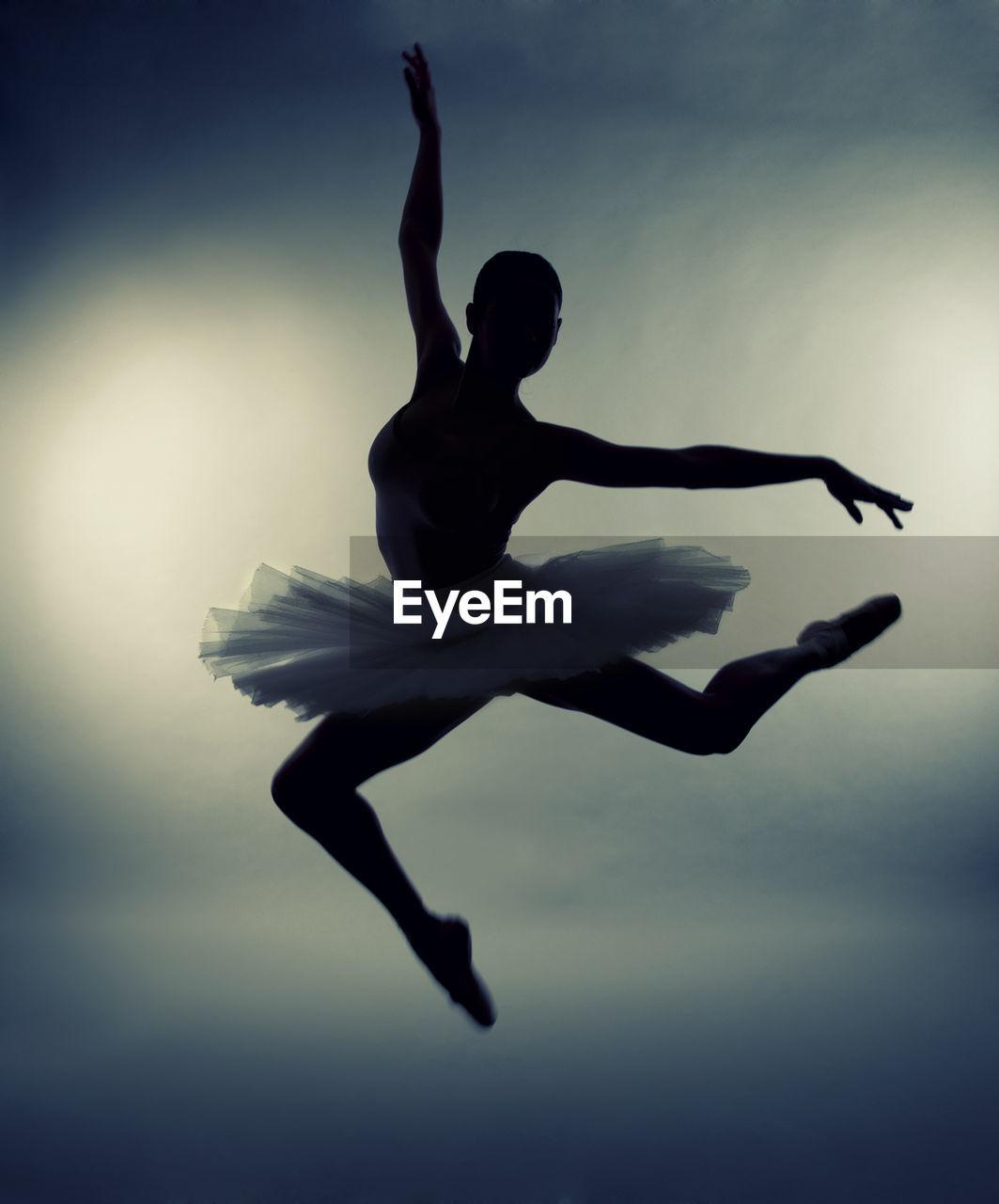 Silhouette Ballet Dancer Performing While Wearing Tutu
