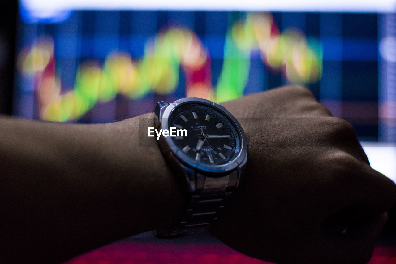 human body part, human hand, hand, one person, watch, real people, time, wristwatch, lifestyles, body part, indoors, leisure activity, close-up, personal perspective, instrument of time, focus on foreground, men, finger, human finger, personal accessory, human limb, checking the time