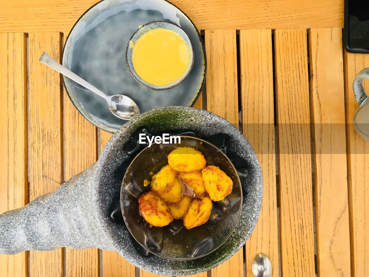 food and drink, food, wood - material, directly above, kitchen utensil, table, freshness, healthy eating, high angle view, household equipment, indoors, no people, wellbeing, bowl, egg, still life, drink, refreshment, close-up, ready-to-eat, frying pan, glass, egg yolk, breakfast