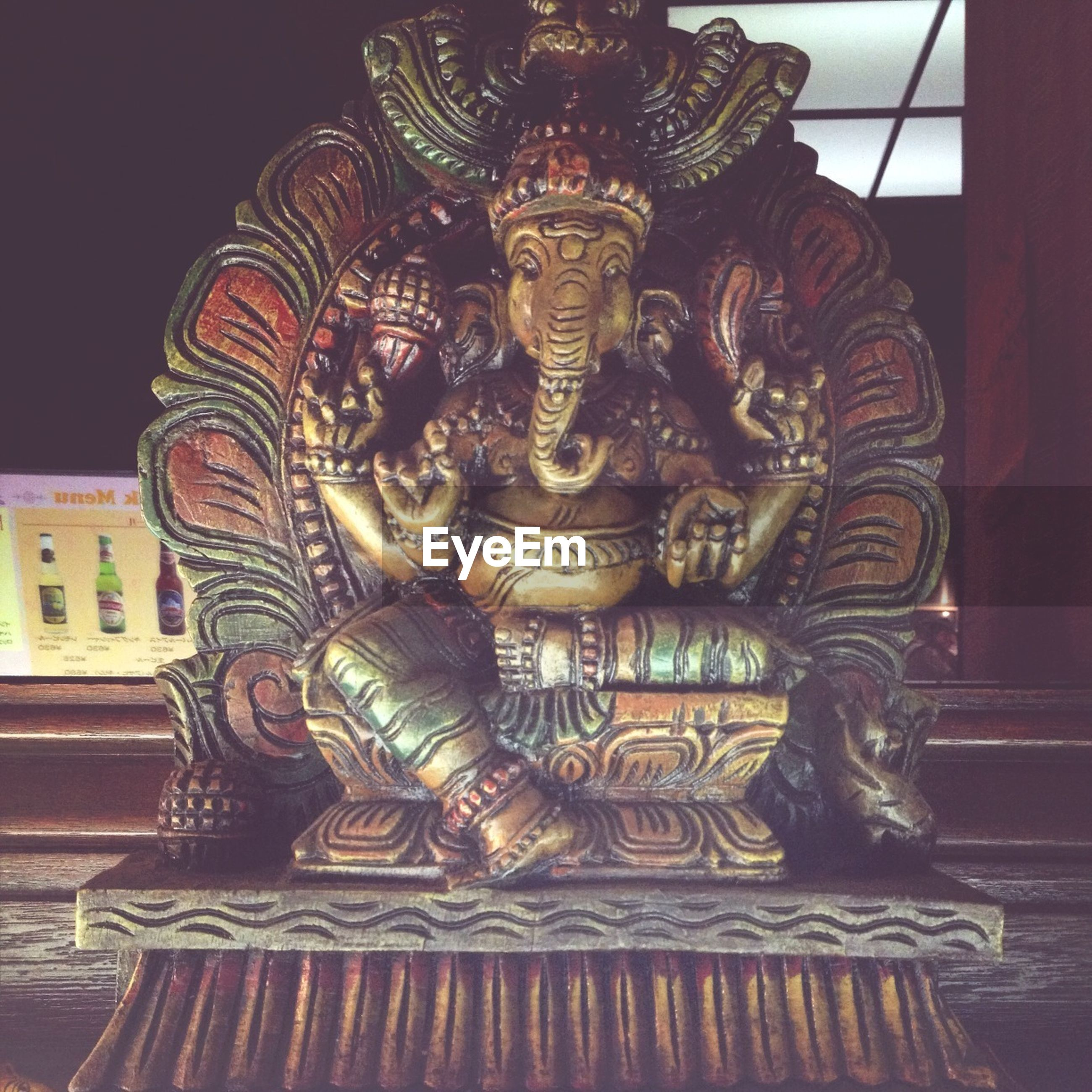 indoors, art and craft, art, creativity, ornate, sculpture, statue, human representation, gold colored, carving - craft product, design, low angle view, religion, spirituality, pattern, place of worship, animal representation, architecture